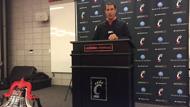 University of Cincinnati coach Luke Fickell speaks Tuesday at his weekly media luncheon, flanked by the Victory Bell. UC has won 11 straight games in the Bell series with rival Miami University, with the teams meeting again Saturday in Oxford.