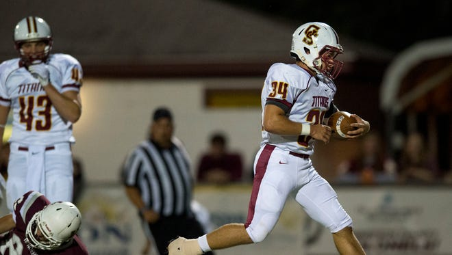 Gibson Southern's Dylan Stefanich (34) scores a touchdown during Henderson County High School's game against Gibson Southern High School at Henderson County High School in Henderson, Ky., on Friday, Sept. 8, 2017. Gibson Southern won 28-20.