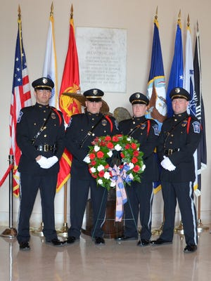Officer Robert Bowling (second from right) and the Fishers Honor Guard is participating in the funeral of Boone County sheriff's deputy Jacob Pickett.