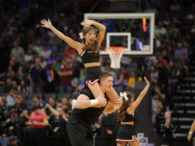 Cincinnati cheerleaders perform during a timeout in