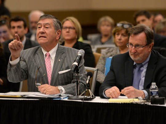 Election lawyers John Pirich, left, and Gary Gordon, who appeared on behalf of Donald Trump's presidential campaign, address the Michigan Board of State Canvassers regarding a request of a statewide presidential election recount by Green Party candidate Jill Stein, Friday, Dec. 2, 2016 at the Lansing Center in Lansing, Mich.