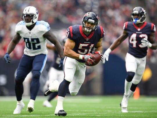 Texans linebacker Dylan Cole (51) takes an interception