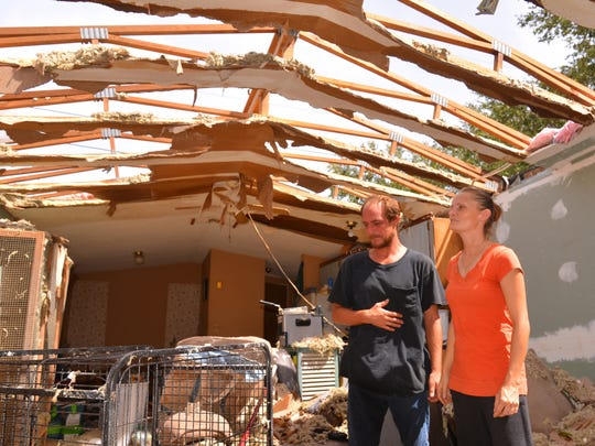 MALCOLM DENEMARK / FLORIDA TODAY Howard Lounsberry  and Teddi Salamacha of  Cape Canaveral had their  trailer destroyed in the  storm. They live in the  Port Canaveral Trailer Park.  People woke up Monday  morning to the aftermath of Hurricane Irma on the Space Coast. Howard Lounsberry and Teddi Salamacha of Cape Canaveral had their trailer destroyed in the storm. They live in the Port Canaveral Trailer Park. People woke up Monday morning to the aftermath of Hurricane Irma on the Space Coast.