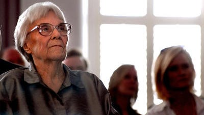 In this 2007 photo, Alabama author Harper Lee listens to speakers at the Alabama Academy of Honor induction ceremony at the Alabama State Capitol Monday.