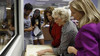 From left, Nicholas Bebelis, Lindsay Metz, Rita Geehan-Miller, Joanne Iwinski-Miller and Lee Clerk of Courts Linda Doggett go through historical records at the Lee County clerk's office on Sept. 11, 2014.