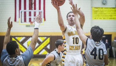 Monroe Central's Beau Combs shoots past the defense in a game last season.