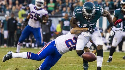 Nelson Agholor can't hang on to a pass in the fourth quarter. Earlier, he had a 53-yard  touchdown reception, the first of his career.