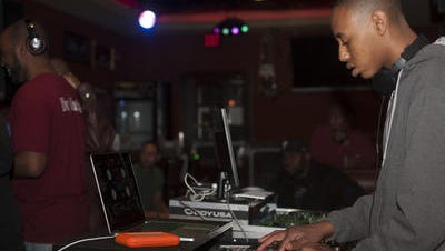 Nick Tyson, DJ Nick, puts in some work on the turntables recently at Roman's Pizza and Pub in Pennsauken. Tyson, 16, is a Cherokee teen, who is also autistic.