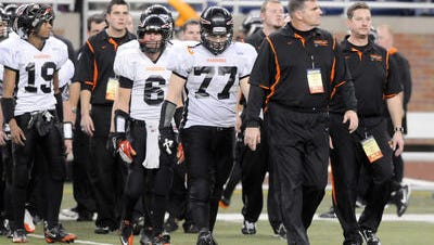 Tony Scarcelli leads his team onto the field the state championship game at Ford Field in 2007.