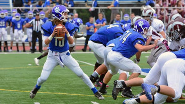 Metuchen's Will Hronich (10) passes against South River