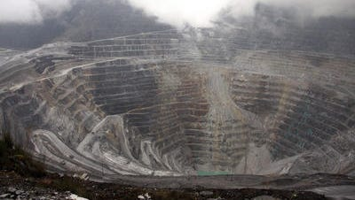 This photograph taken on August 16, 2013, shows a general view of the Freeport McMoRan's Grasberg mining complex, one of the world's biggest gold and copper mines, located in Indonesia's remote eastern Papua province.