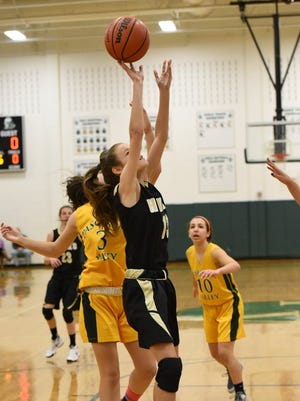 Julie McGovern is a 5-foot-11 point guard and floor leader for River Dell.