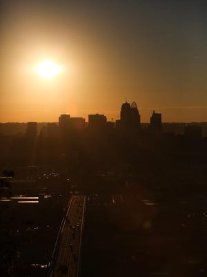 Sun rises over Downtown on Wednesday, as seen from East Price Hill.