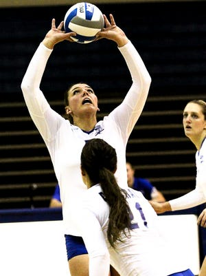 Makenna Lommori sets the ball to a spiker during a Central Connecticut University volleyball match last year. Lommori is entering her junior season this month, her third year as starting setter at the NCAA Division I program.