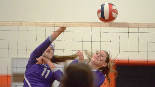 Yerington's Ashley Rife (left) and Chloe Dane attack at the net in last Saturday's championship match win over Incline.