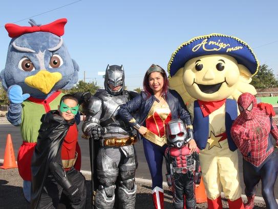 Operation Hope Super Heroes stand alongside Lea, the