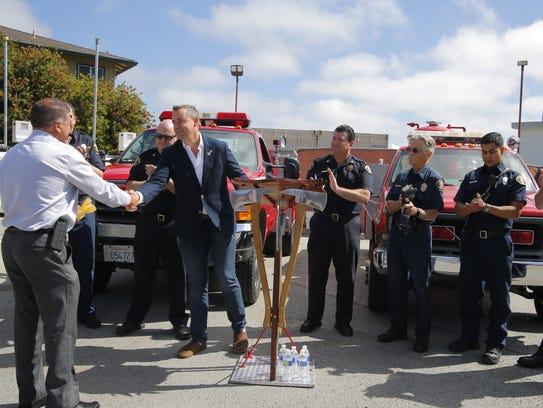 Salinas City Councilman Steve McShane shakes hands