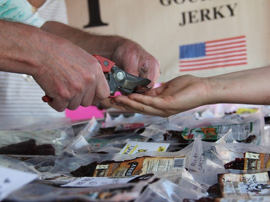 Tim Bakke provides a sample at the Bakke Brothers jerky