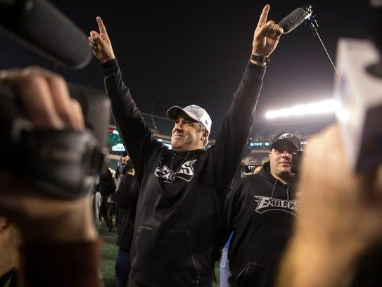 Philadelphia Eagles head coach Doug Pederson raises