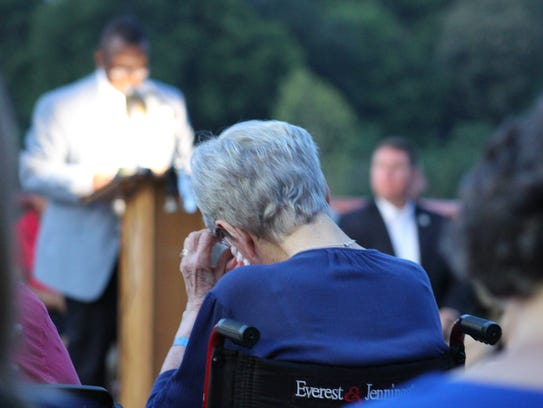 Bonnie Clarius wipes tears as Pineville Mayor Clarence Fields (left) speaks about her sons Tuesday evening during the 21st annual Law Enforcement Memorial Service. Clarius, the mother of slain Jefferson Parish Deputy Jimmy Clarius, told Fields that she would be at the service even though she held a funeral earlier that day for another son, John Clarius Jr.