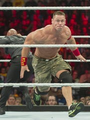 John Cena heads towards the ropes. WWE Live! comes to Germain Arena in Estero on Aug. 28.