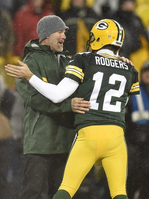 Brett Favre greets Aaron Rodgers during halftime of the Packers' Thanksgiving game in 2015.
