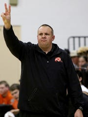 Nocona head boys basketball coach Bret Botard signals to his team in the game against Bowie Tuesday, Dec. 19, 2017, in Nocona.