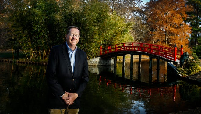 Michael D. Allen, the new executive director of the Memphis Botanic Garden stands among the changing foliage in The Japanese Garden in December 2016. Allen, who was previously worked as president and CEO of Catholic Charities of West Tennessee and before that at International Paper was named the new director in November.