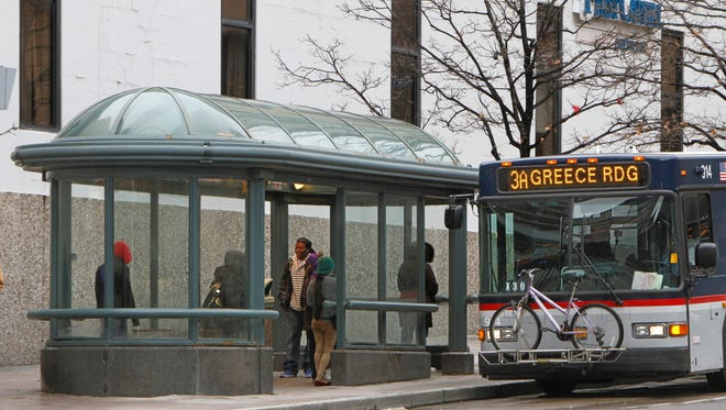 An RTS bus pulls up to a bus shelter on the East Main Street.