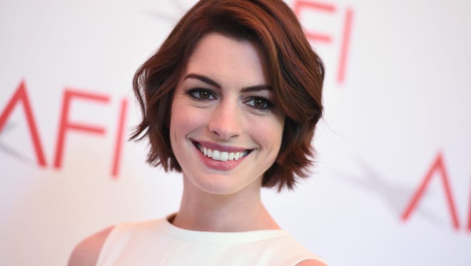 In this Friday, Jan. 9, 2015 file photo, Anne Hathaway arrives at the AFI Awards at The Four Seasons Hotel in Los Angeles.