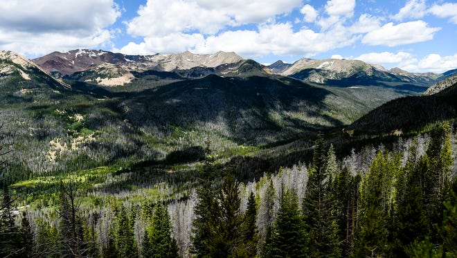 Clouds move over Rocky Mountain National Park, Thursday in July 23.