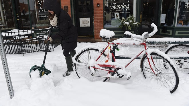 Amanda Hersh shovels snow in old town on Friday, January 8, 2016.