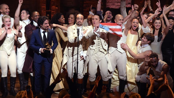 The 'Hamilton' cast performed live via satellite from Broadway at the 2016 Grammy Awards, where the cast album earned a trophy.