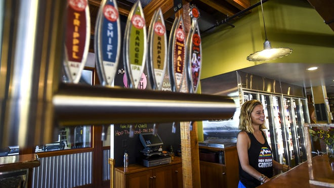 Elle Hart talks to customers at New Belgium Brewing Co. The brewery announced numerous changes to its beer lineup heading into 2017.