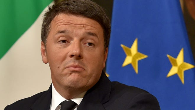 Italy's Prime Minister Matteo Renzi announces his resignation during a news conference following the results of the voteon a referendum on constitutional reforms, on Dec. 4, 2016.
