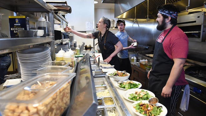 Kate Bristol, Nathan Koehler and Kirk Provost work in the kitchen at Restaurant 415 on Friday, January 27, 2017. The restaurant's inspection rating went from ÒinadequateÓ to ÒexcellentÓ within last year.
