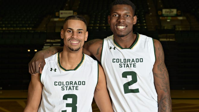 CSU basketball players Gian Clavell and Emmanuel Omogbo were both named to the U.S. Basketball Writers Association All-District VIII team Tuesday.