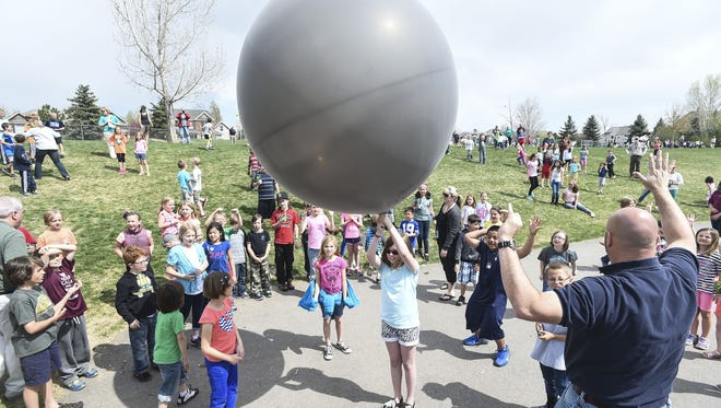 A weather balloon is prepared for release during an Earth Day celebration Wednesday, April 22, 2015 at Werner Elementary School in Fort Collins, CO.