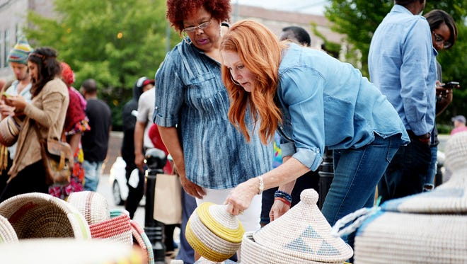 Teressa, left, and Trina Jackson, of Tennessee, shop for baskets made in Africa during Goombay September 9, 2017.