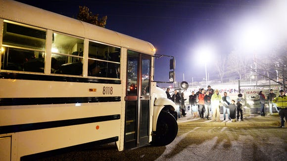 A bus of Pisgah cheerleaders leaves Franklin High School after a football game November 17, 2017.
