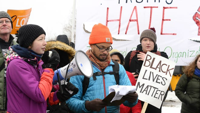 Organizers rally demonstrators in the Staples Plaza parking lot on Saturday, Feb. 20, 2018.The demonstrators had marched from the University of Vermont campus in Burlington in response to rumors that white supremacist rally was planned for the site that day.