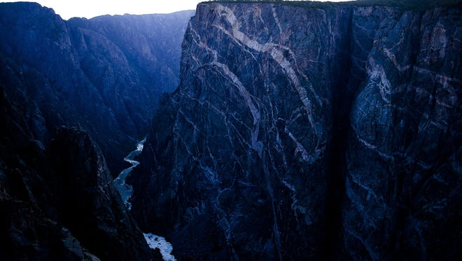 The final bits of light show off the Painted Wall at the Black Canyon of the Gunnison Monday, June 22, 2015. The wall is the tallest vertical wall in Colorado.