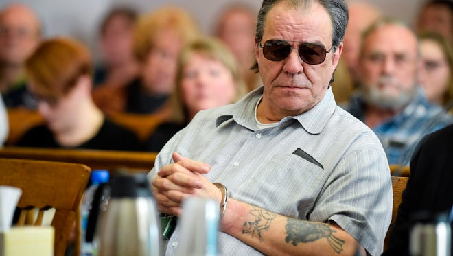 In this March 9, 2018, file photo, Freddie Joe Lawrence listens to testimony in Helena during a hearing to review new DNA evidence related to the murder of Donna Meagher, which Lawrence was convicted of in 1995. A Montana judge has vacated the deliberate homicide conviction of Lawrence and another man in the 1995 death of the Helena woman and ordered new trials.