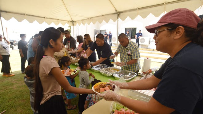 Guam Fire Department personnel served food for people in need at the Kamalen Karidat soup kitchen in Hagatna on Monday May 28, 2018. It was the first time Kamalen Karidat served a feast on World Hunger Day, said Doris C. Royal, program director of the Achdiocese of Agana's Ministry to the Homeless. Since 2011, World Hunger Day is an initiative by The Hunger Project. Started in 2011, it aims to celebrate sustainable solutions to hunger and poverty.