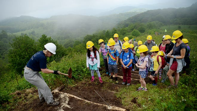 """Ann Hendrickson, a Carolina Mountain Club trail crew leader, shows a group from the Youth Partner Challenge how much work goes into creating a trail June 2, 2018.  """"Max Patch is being loved to death,"""" Hendrickson said. """"We're hopeful this event will give people a greater appreciation for our trail, and hopefully more people will want to volunteer. A lot of stress is being put on our wild places. We firmly believe people will take care of what they feel is of value. Education is key."""""""