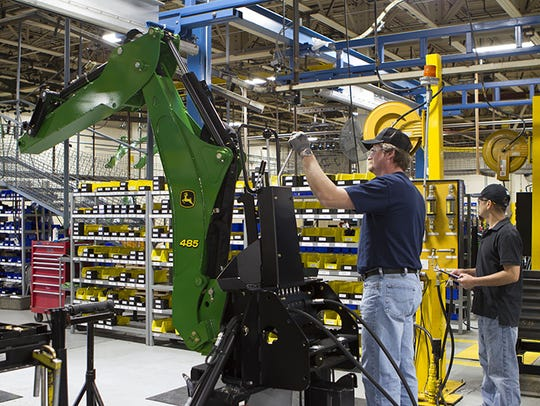 Amerequip employees work on machinery for John Deere