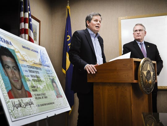 Sen. Steve Daines, R-Mont., joined by Montana Attorney General Tim Fox, right, discusses Montana's noncompliance with the federal REAL ID Act during a 2016 news conference showing the state's new driver's license at the Attorney General's Office.