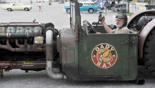 """""""This unit is called a rat rod by design. And this is the biggest rat rod we've seen, so we call it 'The daddy of all rats,'""""said John Stauffer of Lancaster County. It is a vehicle that he and his son, Todd, built and brought to the York Expo Center on Thursday. According to Stauffer, he, his son and grandson, Cordell, put in approximately 1,500 hours building the rod, which has parts from an Ingersoll Rand bulldozer, a military vehicle, a school bus and sports a horn from a Nathan P5 Union Pacific Locomotive."""