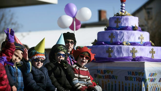 Children from the St. Paul's UCC Church of Schaefferstown ride aboard a birthday themed float. The  2015 Lebanon Holiday parade got underway right on schedule, jumping off from Lincoln and Cumberland. Dozens of floats and groups marched in the parade, including bands from almost every high school in the county.