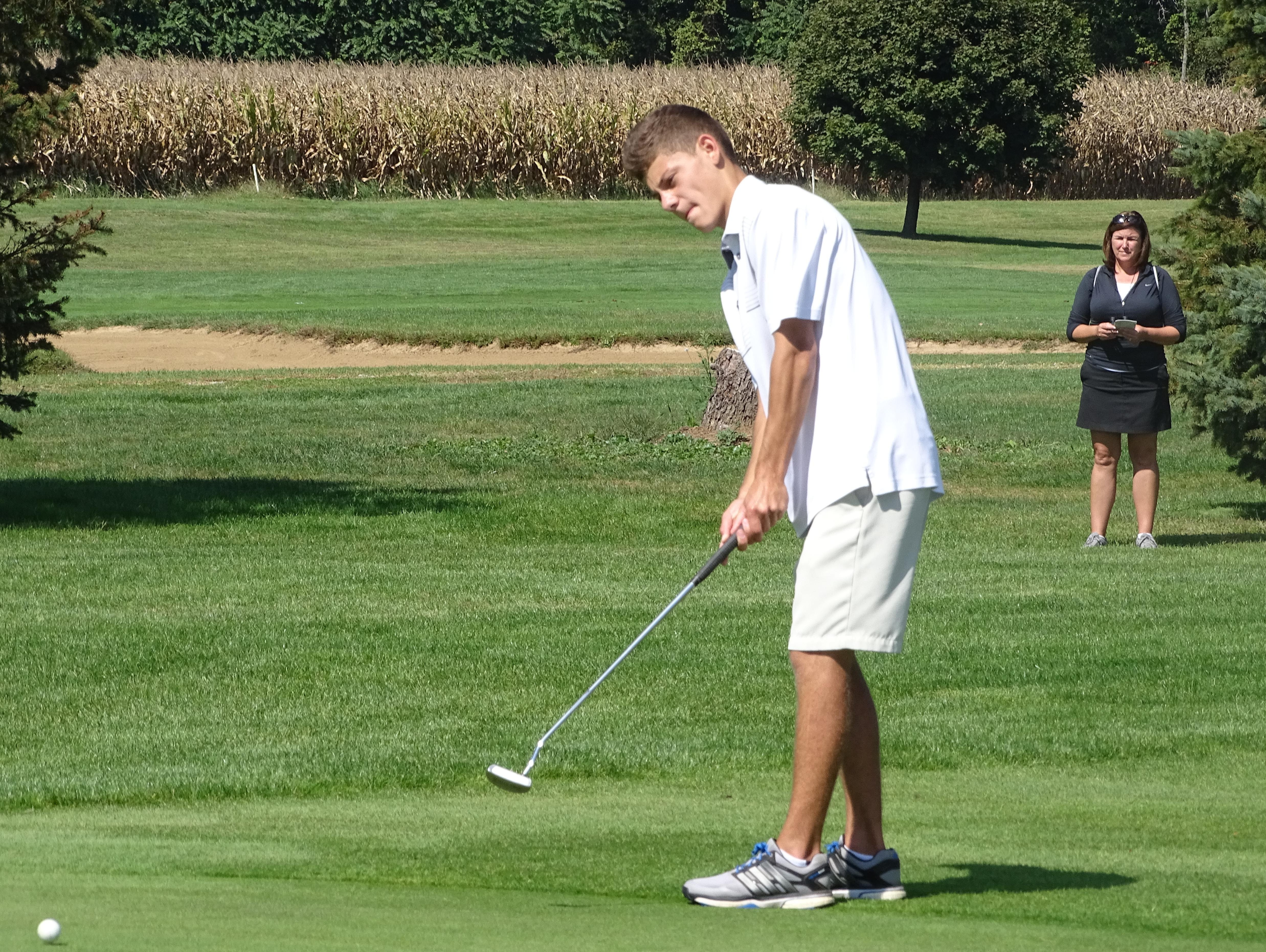 Zanesville's J.J. Burns putts Wednesday in the second round of the ECOL Tournament on Wednesday at River Greens. Burns, a senior, shot 80 as the Blue Devils placed second in the Scarlet Division.